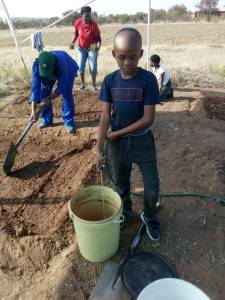 boy filling bucket
